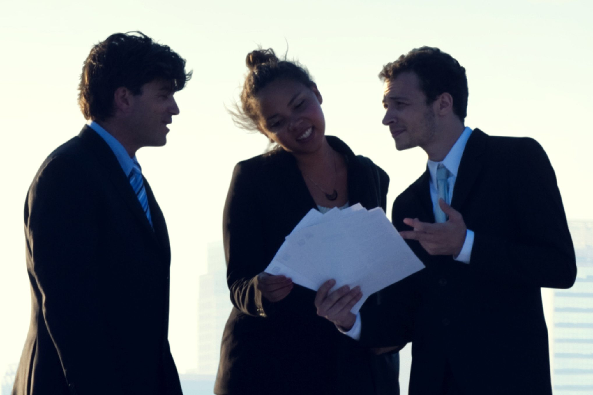 Three business professionals talking